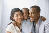 African American family hugging — Stock Photo