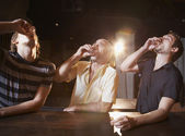 Hispanic men drinking shots at bar — Stock Photo