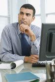 Hispanic businessman thinking — Stock Photo