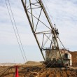 Stock Photo: Powerful dredge digs hole