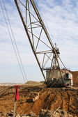 The powerful dredge digs a hole — Stock Photo