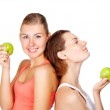 Two young beautiful women with an apples — Stock Photo