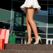 Woman legs with shopping bags — Stock Photo