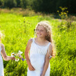 Stock Photo: Cute little girl on the meadow in summer day
