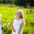 Cute little girl on the meadow in summer day — Stock Photo #12665781