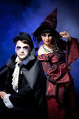 Man and woman wearing as vampire and witch. Halloween — Stock Photo