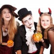 Teenagers dressed in costumes for Halloween against white backg — Stock Photo