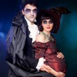 Man and woman  wearing  as  vampire and  pregnant witch. Hallowe — Stock Photo