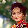 Stock Photo: Womwearing retro felt hat . Outdoor