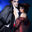 Man and woman  wearing  as  vampire and  witch. - Stock Photo
