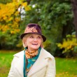 Mature woman wearing retro felt hat and wool coat . Outdoor — Stock Photo