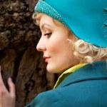 Woman wearing retro felt hat and wool coat . Outdoor — Stock Photo