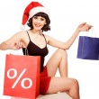 Woman wearing santa hat on white background holding discounting — Stock Photo