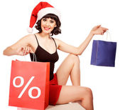 Woman wearing santa hat on white background holding discounting — 图库照片