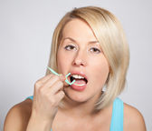 Positive blond woman checks her teeth — Stock Photo