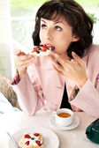 Women drinking coffee in café smiling — Stock Photo