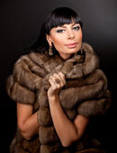 High fashion model wearing fur vest — Stock Photo