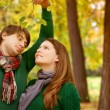 Stock Photo: Pregnant couple have fun in the park