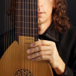 Man and his  ancient lute - Stock Photo