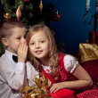 Little boy and girl near Christmas tree and gifts — Stock Photo #16870593