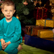 Little boy and near Christmas tree and gifts — Stock Photo