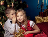 Little boy and girl near Christmas tree and gifts — Stock Photo
