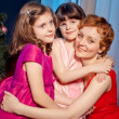 Mother and daughters near Christmas tree — Stock Photo