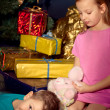 Little boy and girl near Christmas tree — Stock Photo