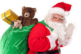 Santa Claus holding bag — Stock Photo