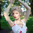 Pin up girl posing in park — Stock Photo #18293961