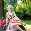 Pin up girl posing in park — Stock Photo #18293981