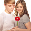 Teenager preset his girlfriend flower. Valentine day. — Stock Photo #18294089