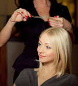 Haircutter in salon — Stock Photo