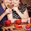 Attractive couple have fun in kitchen at Valentine day — Stockfoto #18958825