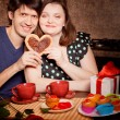 Attractive couple have fun in the kitchen at Valentine day — Stock Photo