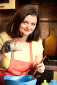 Plus size attractive woman preparing cupcake for her boyfriend — Stock Photo