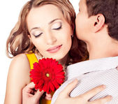 Attractive couple of lovers. Man presents flower. Valentine s d — Stock Photo