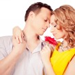Stock Photo: Attractive couple of lovers. Man presents flower. Valentine s d