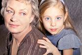 Girl and grandmother — Stock Photo