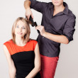 Stylist ironing hair — Stock Photo