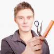 Stock Photo: Haircutter holding scissors