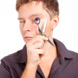 Foto Stock: Stylist holding scissors