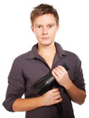Haircutter holding hairdryer — Stock Photo
