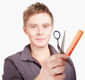 Haircutter holding scissors — Stock Photo