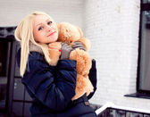 Pregnant woman hold bear — Stock Photo