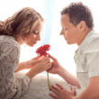 Royalty-Free Stock Photo: couple of lovers. Man presents flower