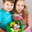 GIrl and boy wearing as Easter Rabbit sitting on the grass — Stock Photo