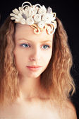 Beautiful young girl wearing handmade felt adornment — Stock Photo