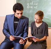 Teacher explaining — Stock Photo