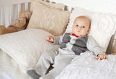 Little boy laying on the bed — Stock Photo